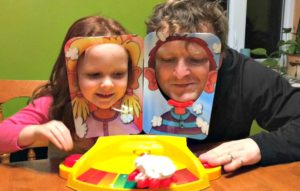 family game time pie face father daughter