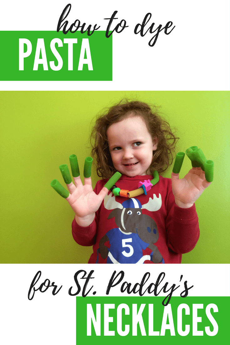toddler with dyed green pasta for st. patrick's day activities