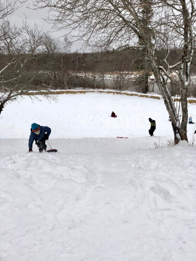 Kids at Best sliding sledding toboggan hills moncton salisbury New Brunswick pickle planet
