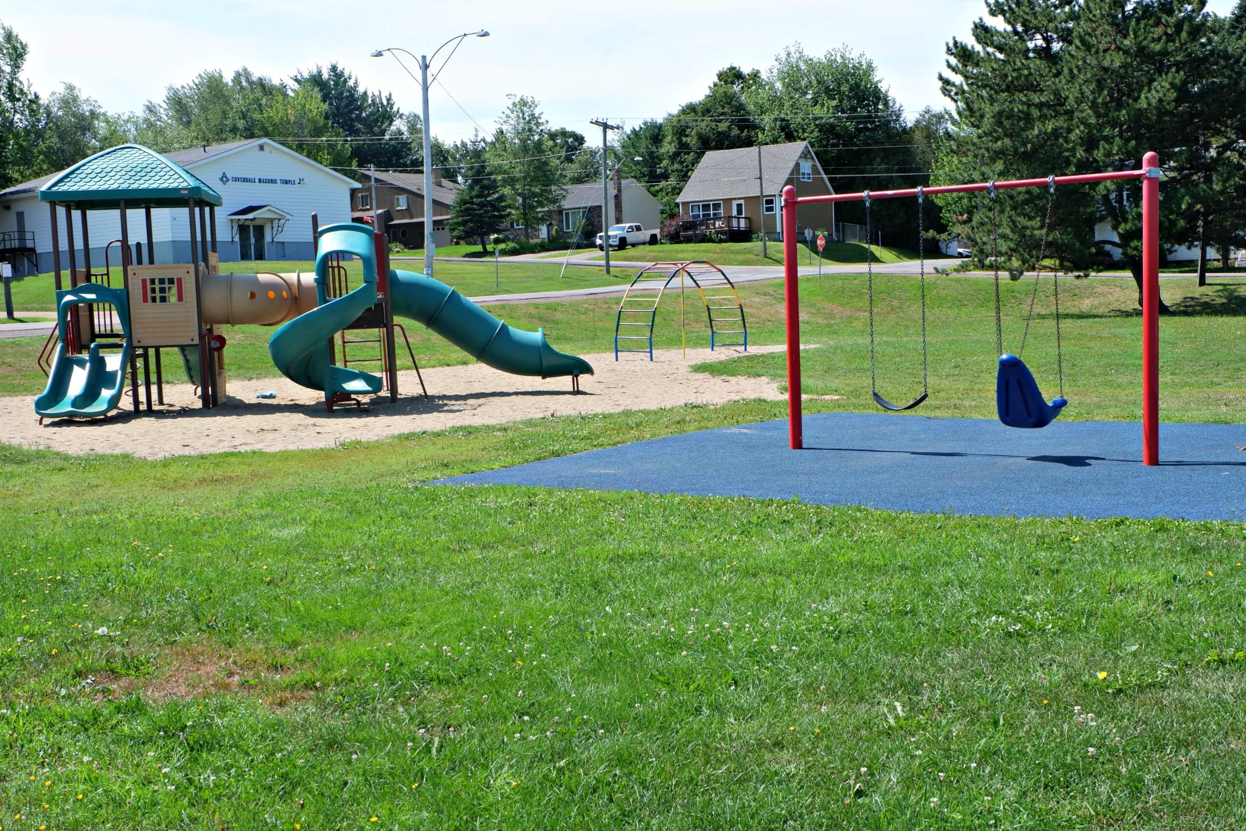 riverview patricia park tot lot accessible playground pickle planet swing