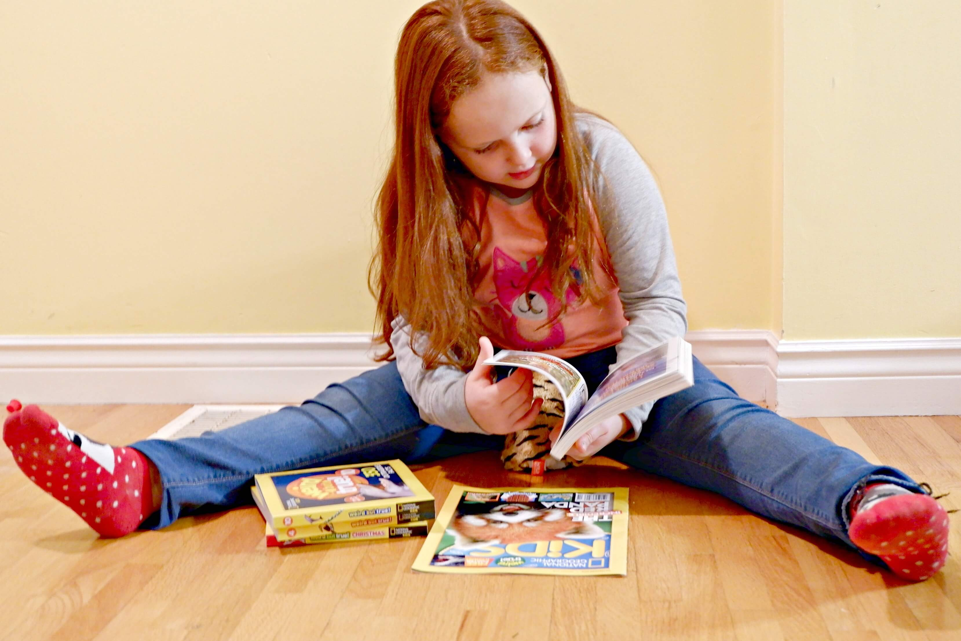 young girl reading books national geographic canada facts book weird but true early reader pickle planet