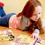 young girl reading national geographic canada facts book weird but true reading learning early literacy pickle planet