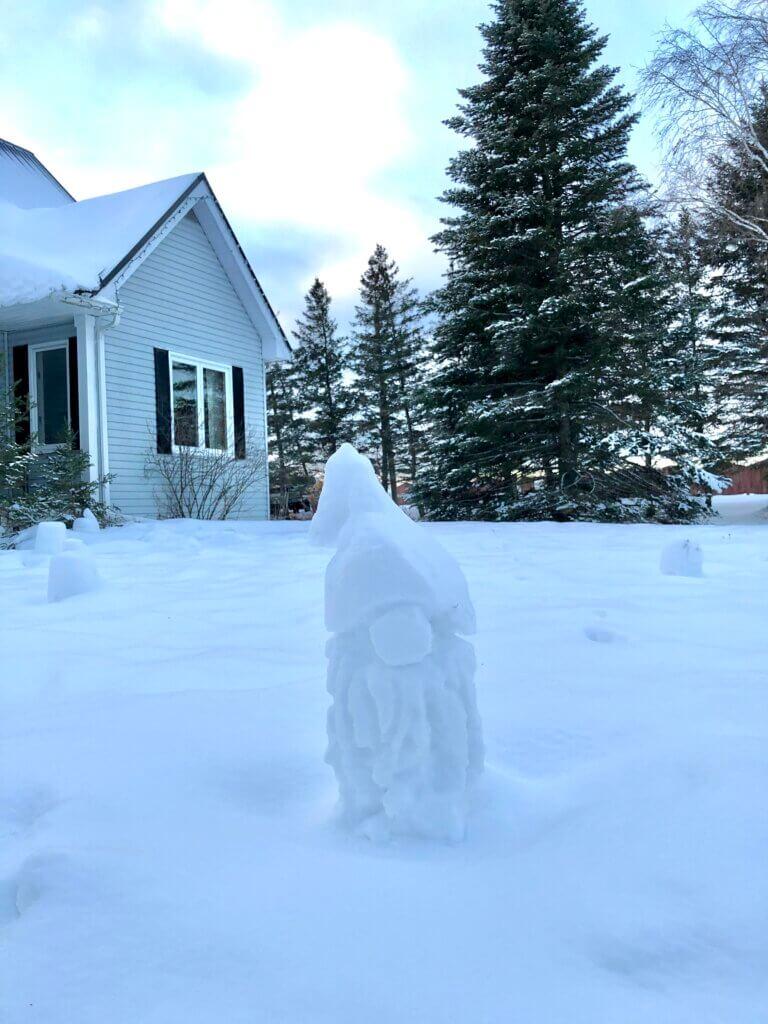 a snow gnome on pickle planet moncton's front lawn