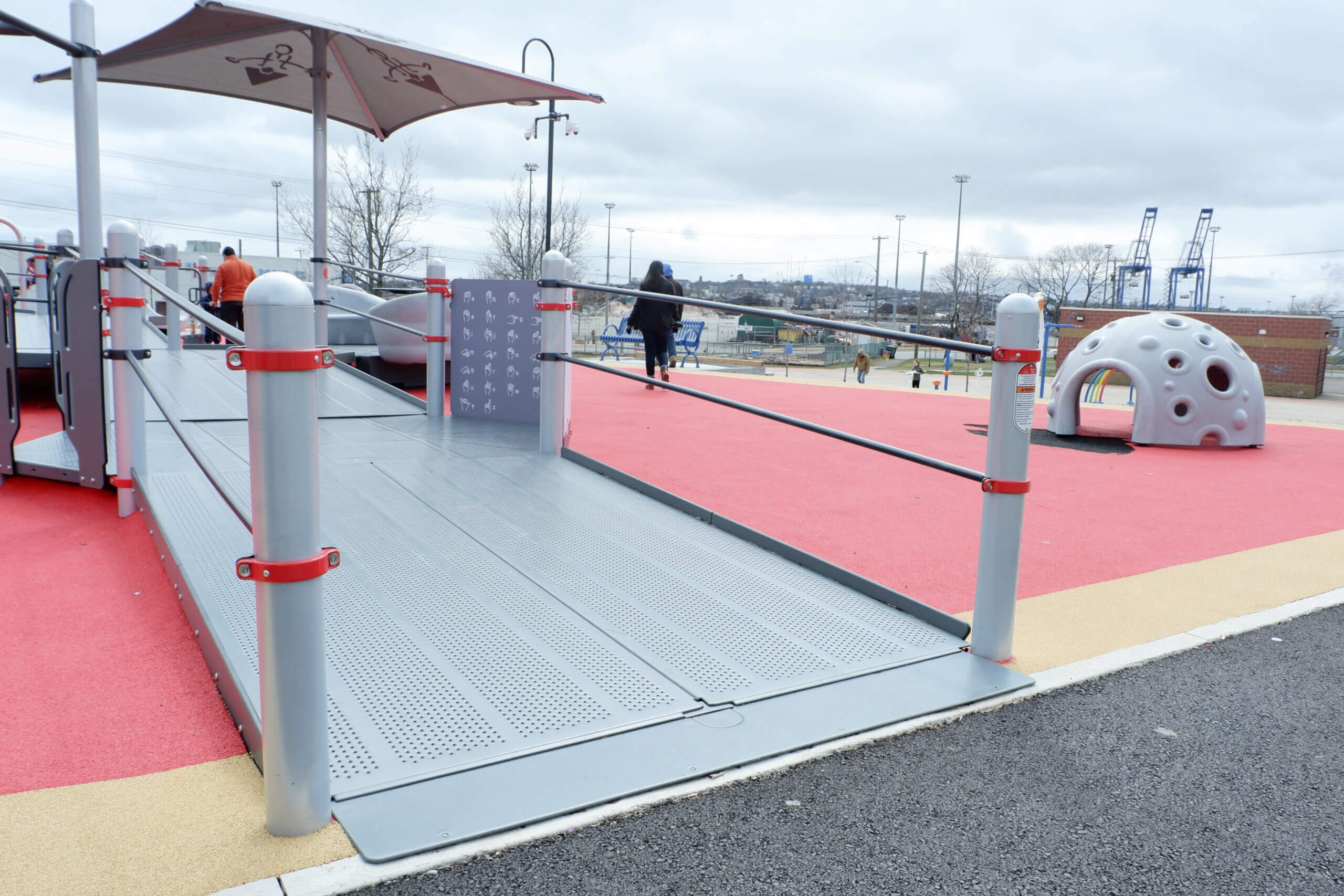 saint john rainbow park accessible inclusive playground double wide ramps rubberized ground pickle planet profile