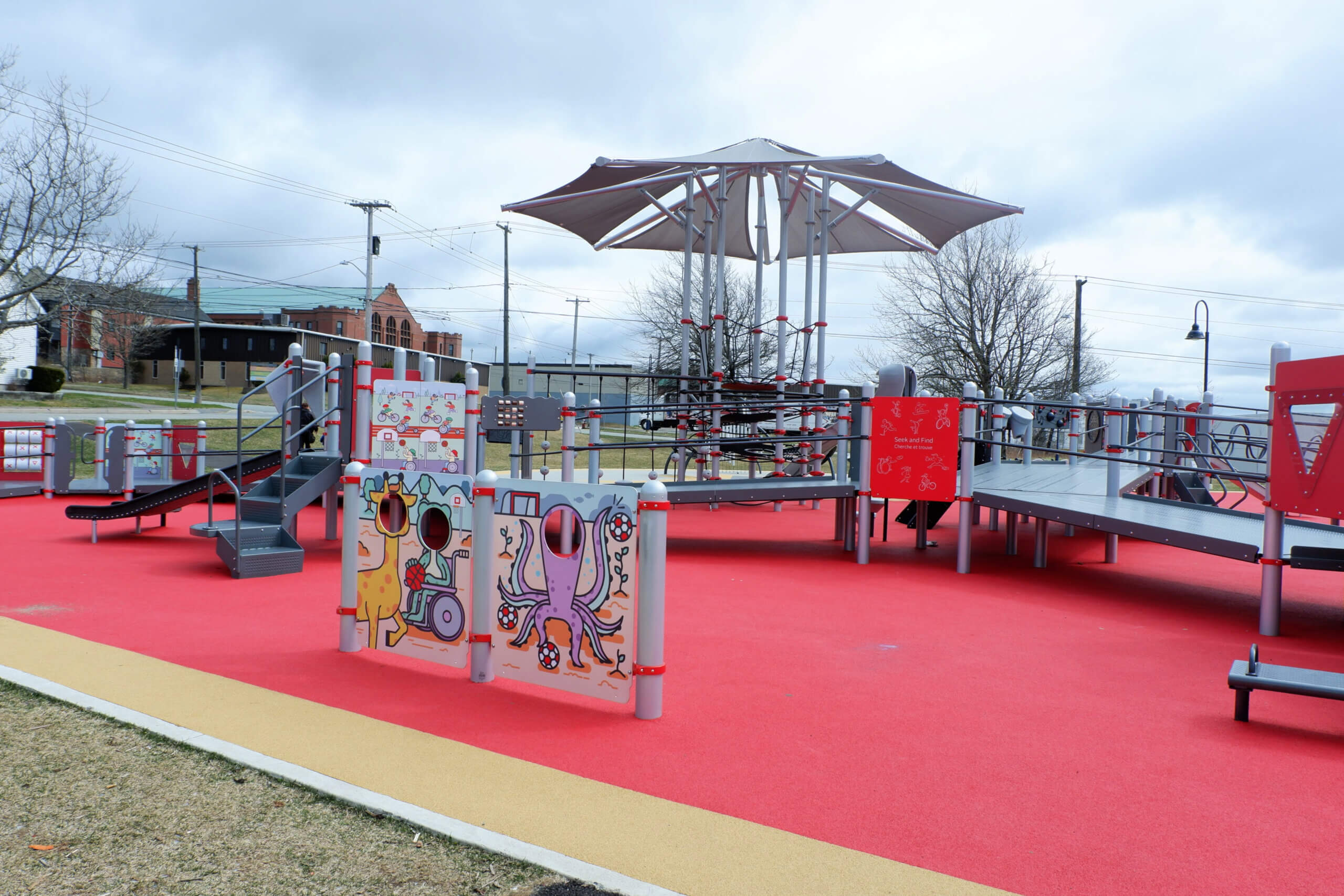 saint john rainbow park accessible inclusive playground wide ramps rubberized ground things to explore with kids pickle planet