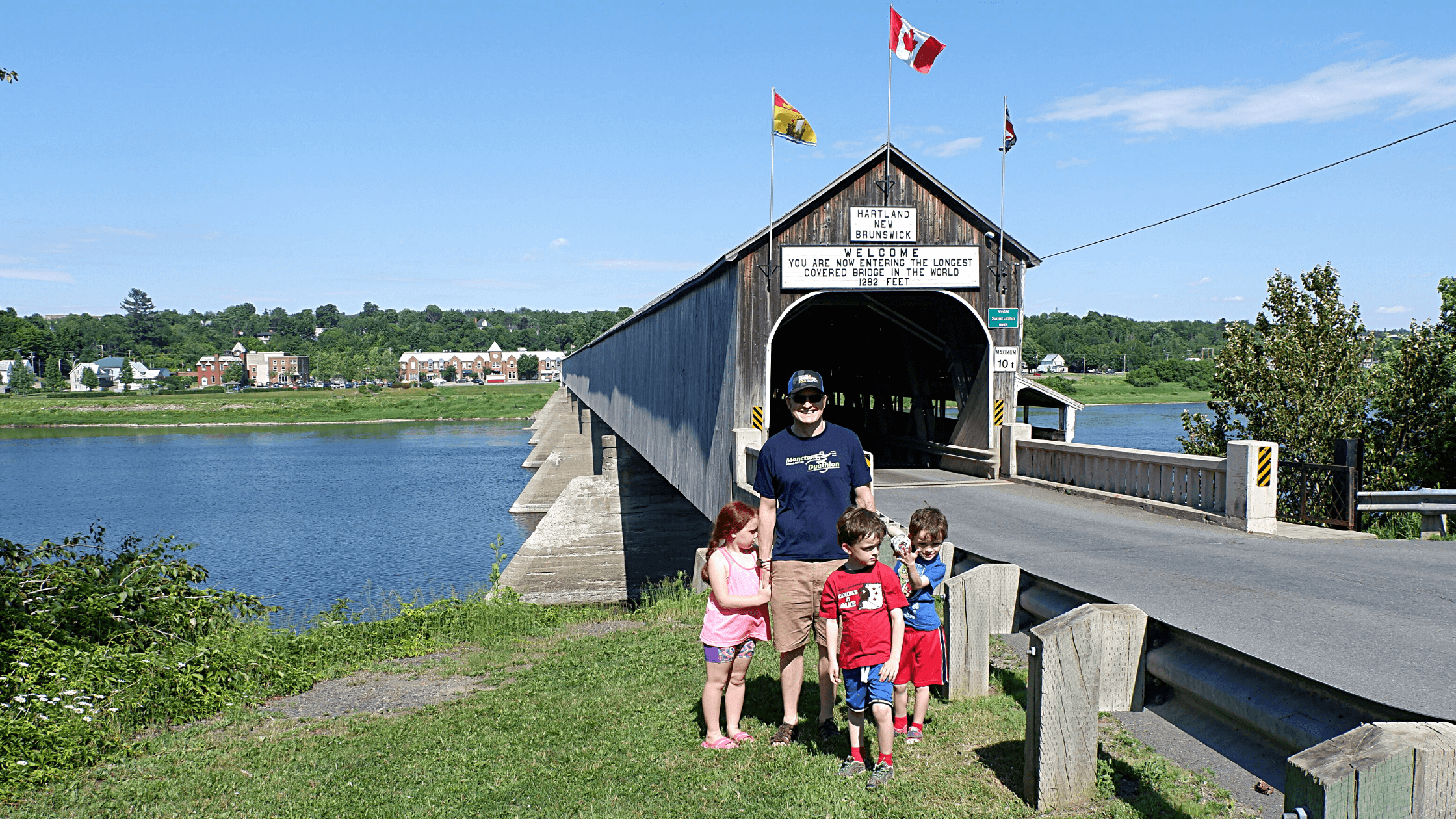 Pickle Planet Moncton family visiting the longest covered bridge in the world at Hartland New Brunswick