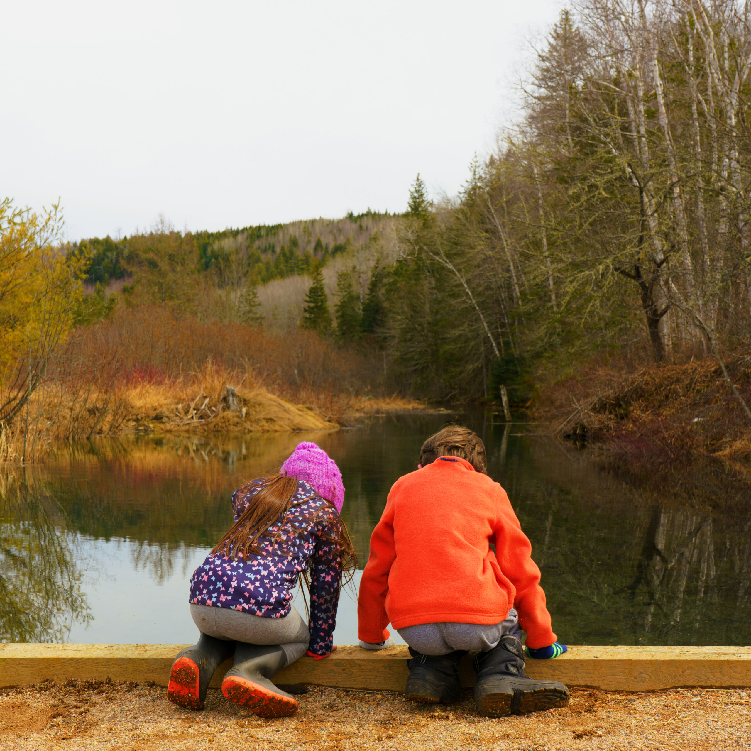 two young children by the river in new brunswick