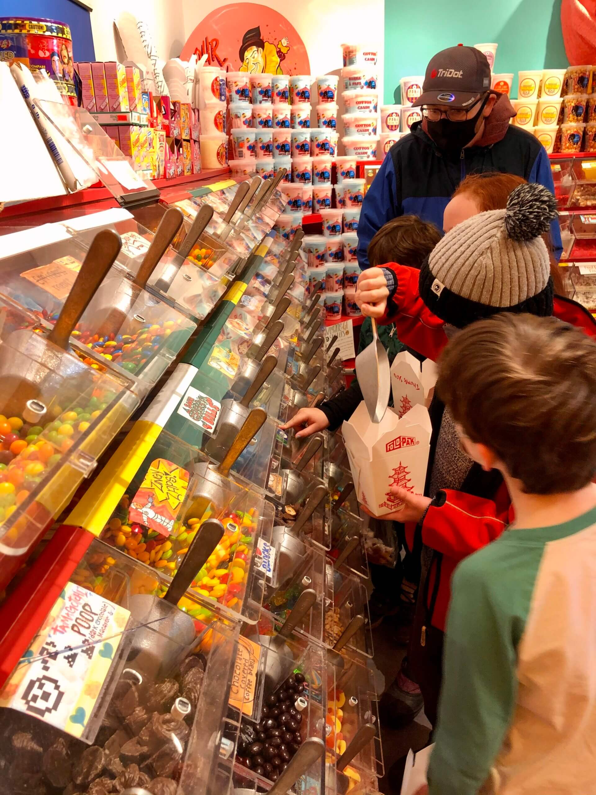 pickle planet children picking out candy at freak lunchbox saint john