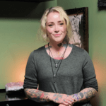 professional piercer ashley hannington in her relaxing green studio room at scarlet ink tattoo parlour riverview new brunswick