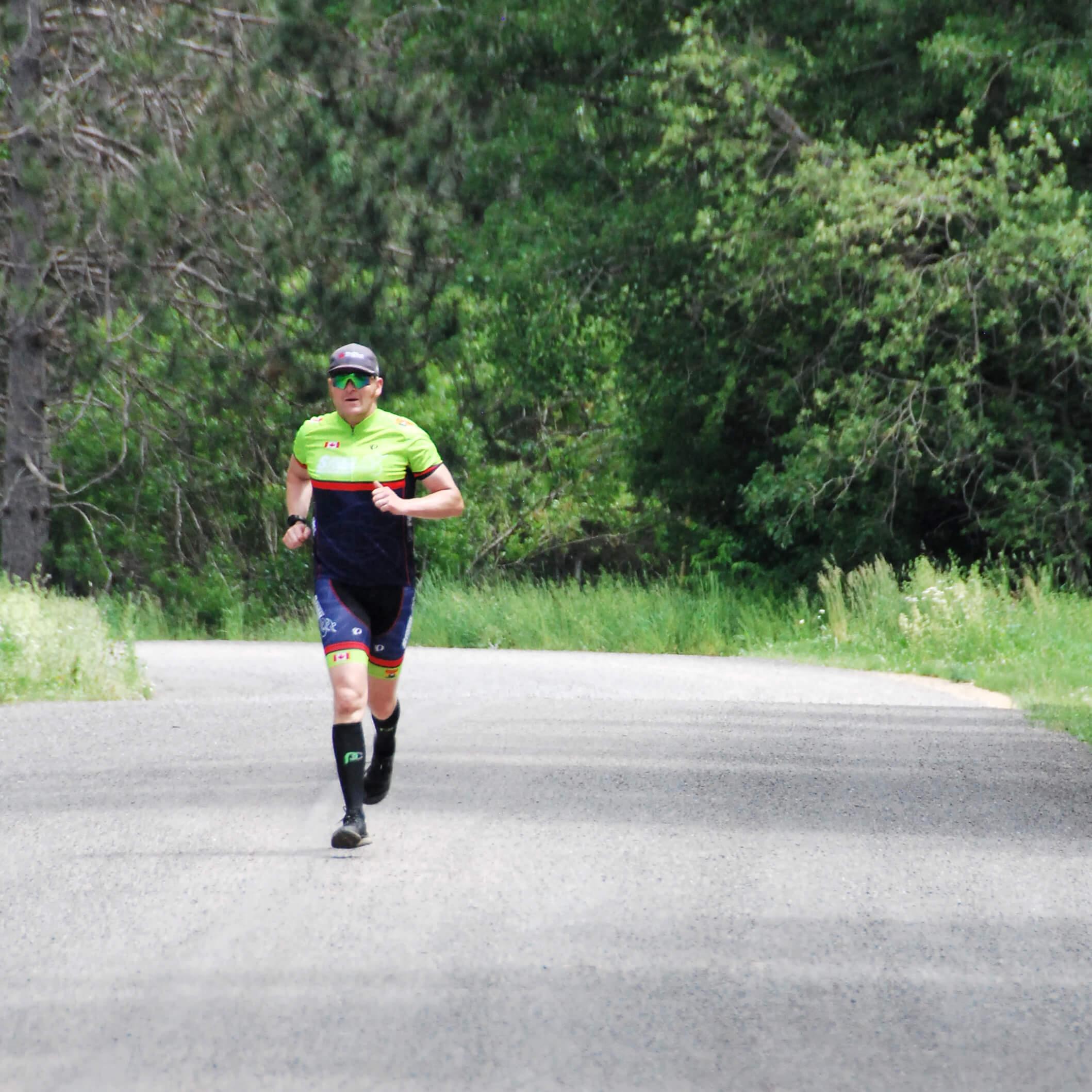 triathlete running on dirt road