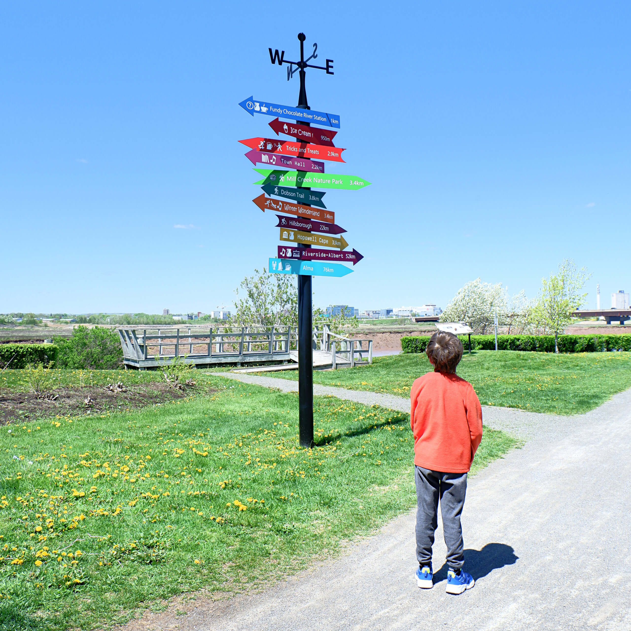 riverview riverfront playground moncton pickle planet sign post